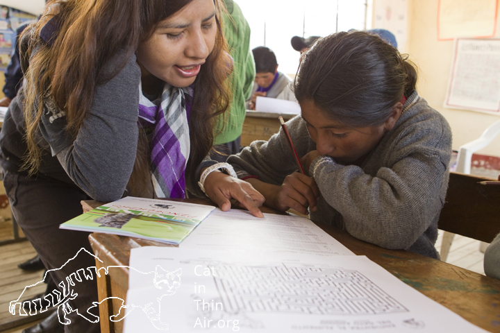 Alejandra helps a student with a quiz about Andean Cats, western Bolivia.